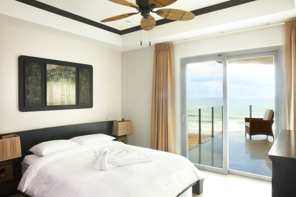 Bedroom #3 with queen bed and shared balcony with a wonderful view of the ocean.