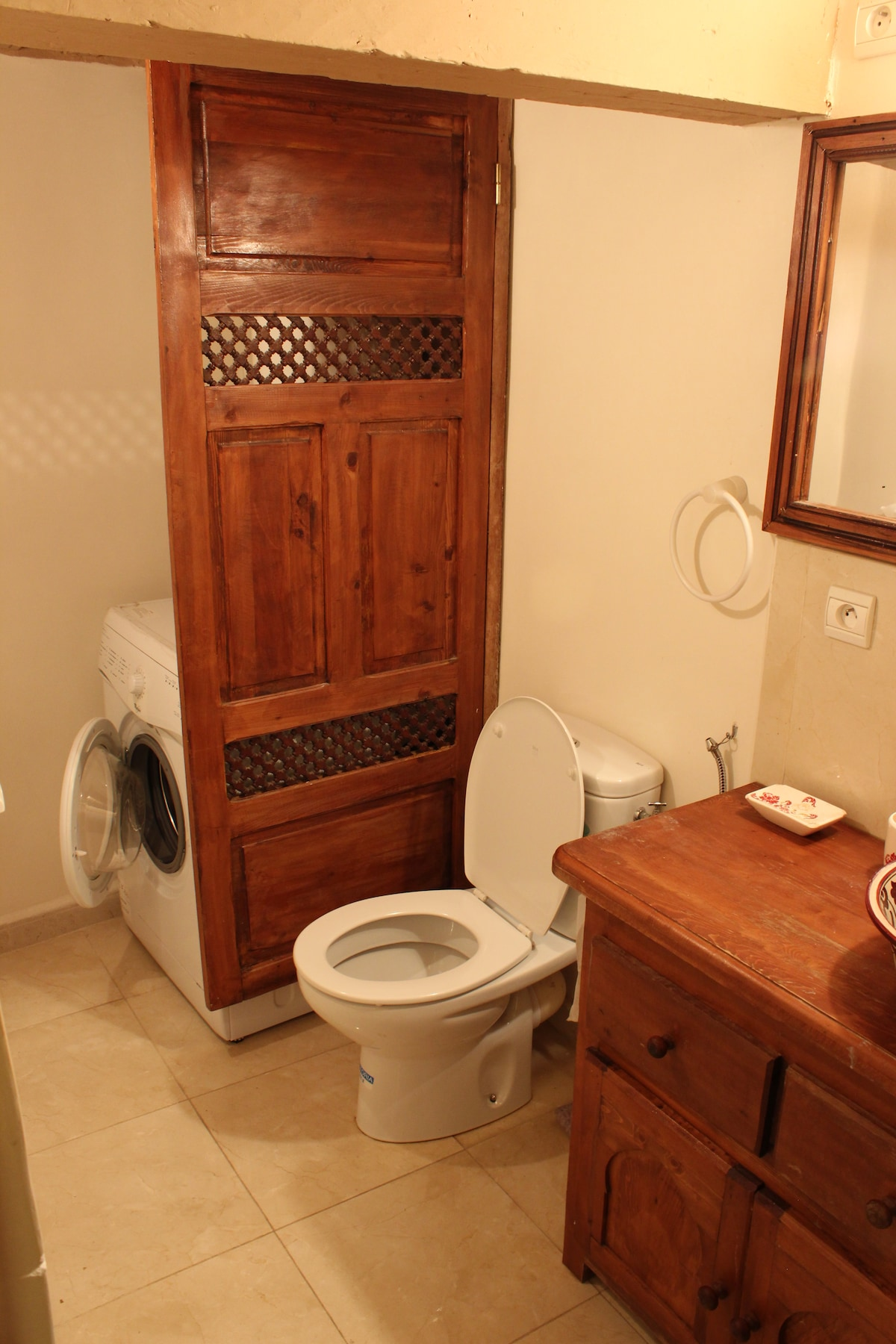 Western style bathroom also has a washing machine and hot water system.