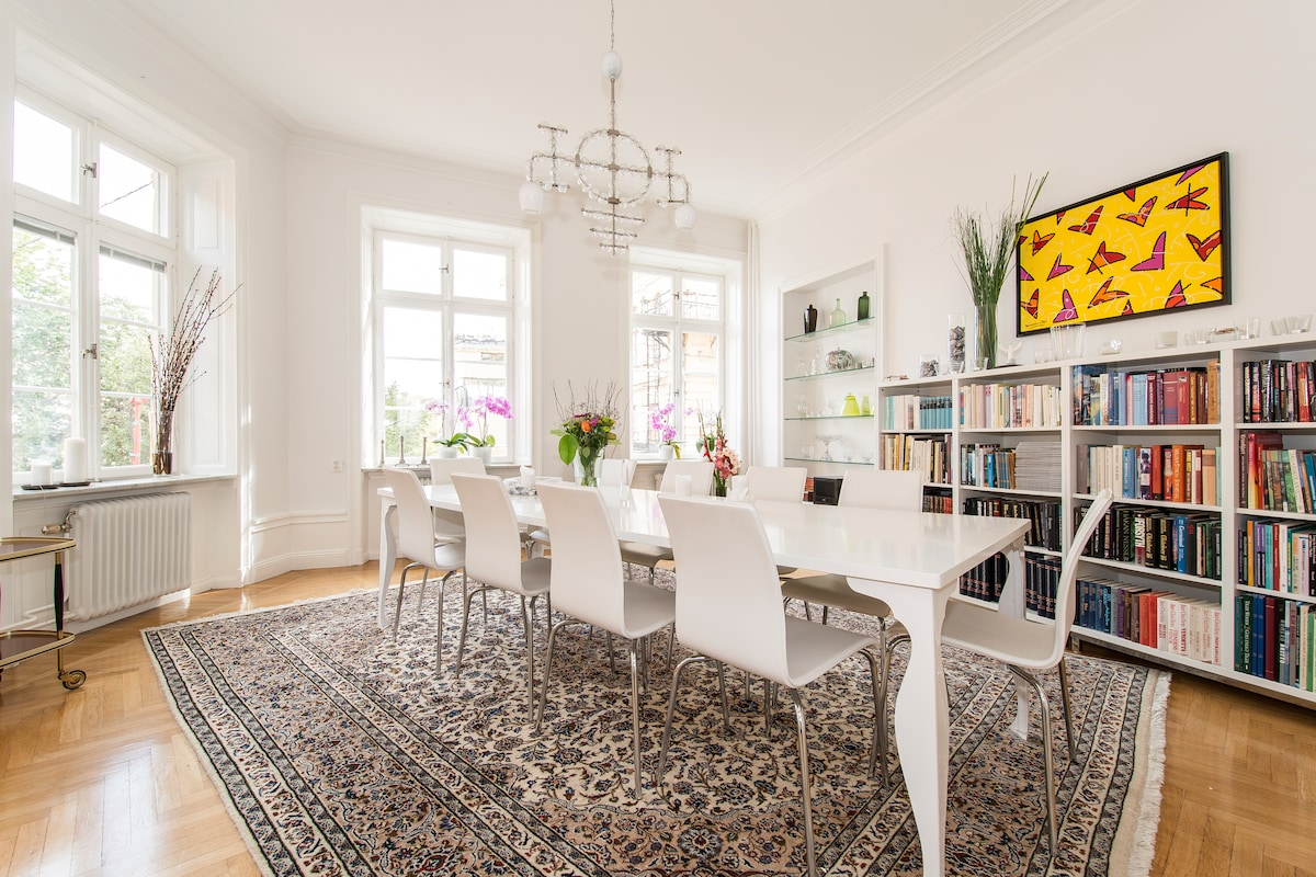 The beautiful Dining Room with table for 10 sitting people to eat