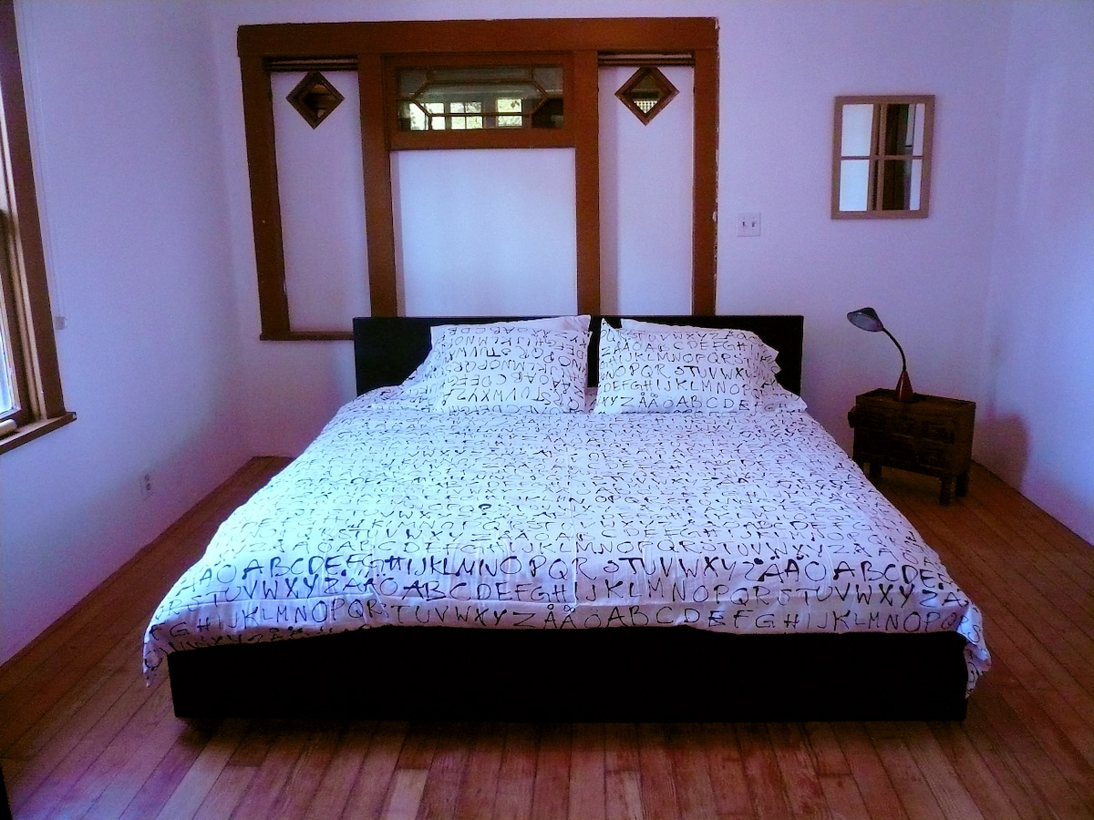 Main bedroom, can be fully enclosed by two sliding doors.