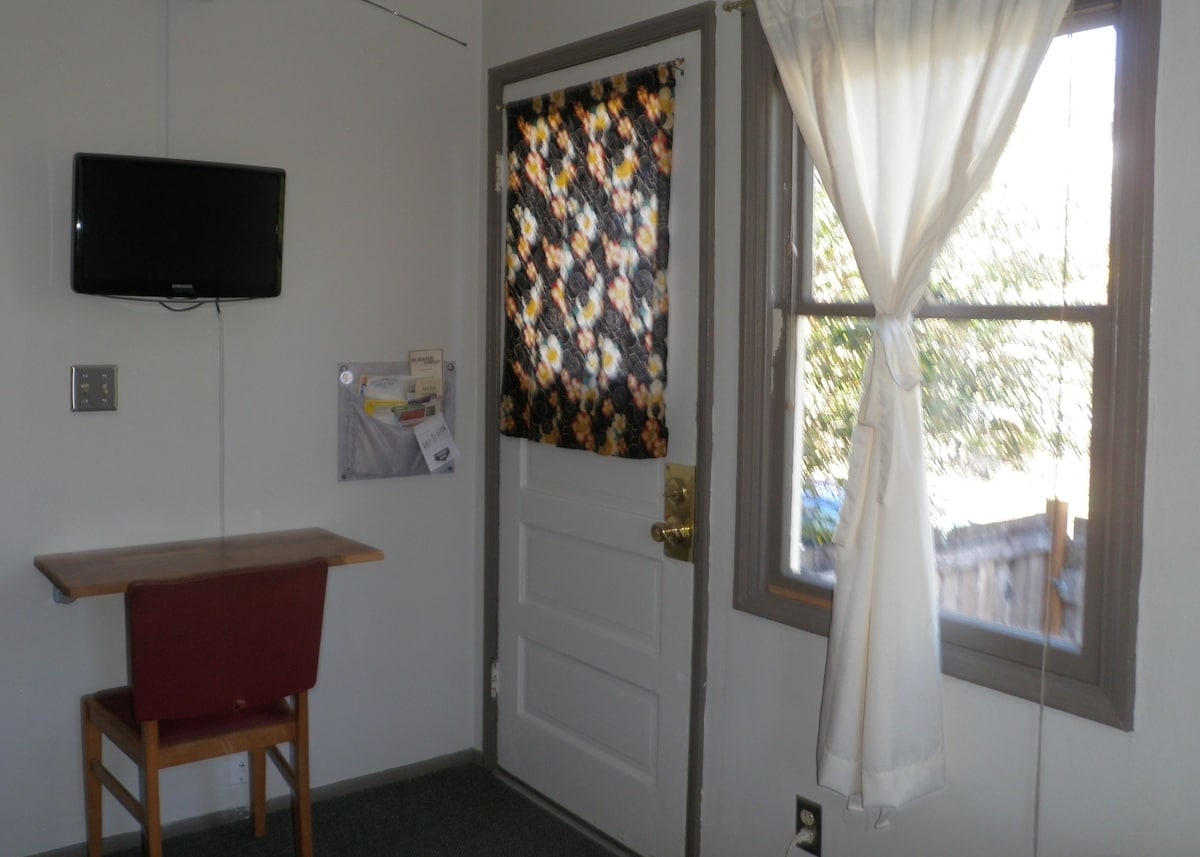 Private entrance opens to patio. Desk just the right size for a laptop. Also flat screen tv.