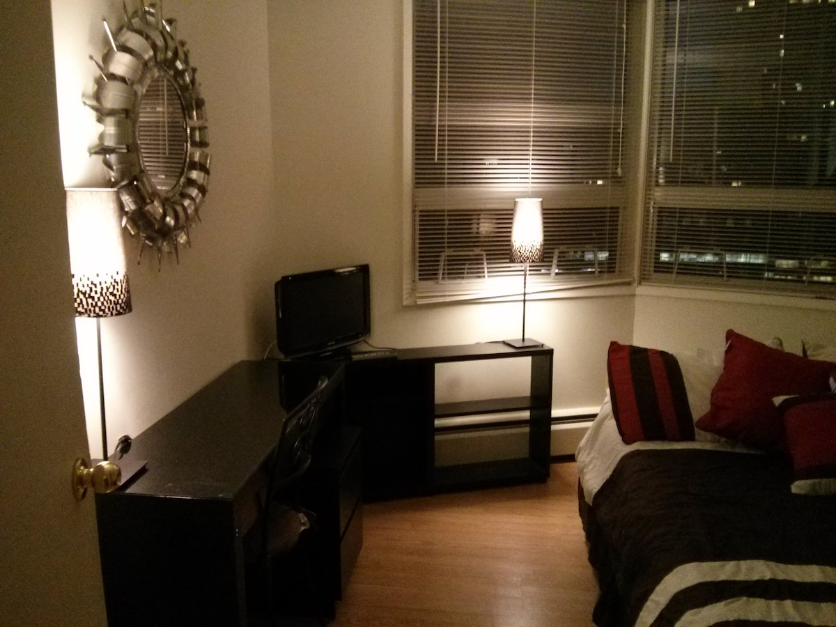 Desk, TV, night table, two table lamps and book case