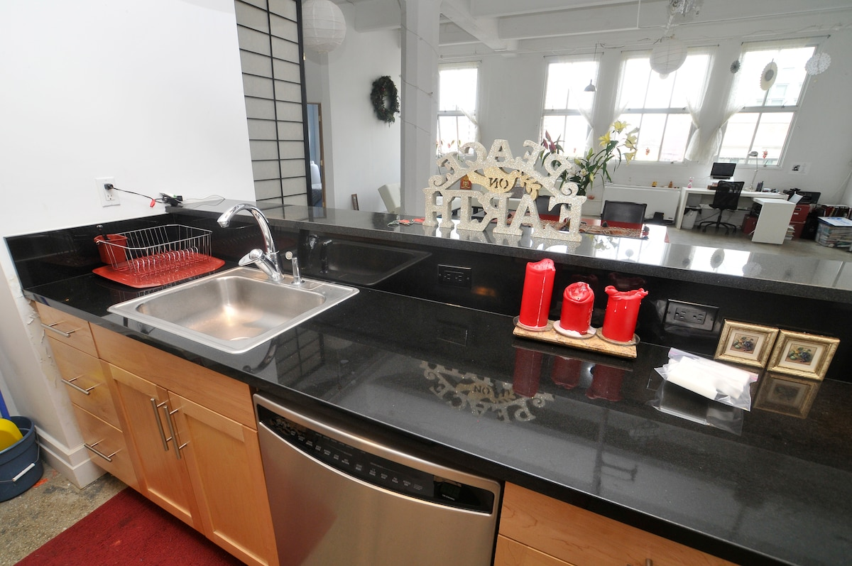 Open kitchen with stainless steel appliances, full set of cookware and granite counter tops; gets light all day