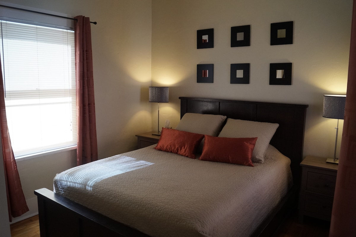 Main Bedroom with comfy queen size bed.