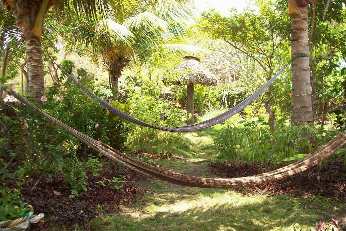 Double hammocks hung in the gardens for relaxing and enjoying the lake breezes