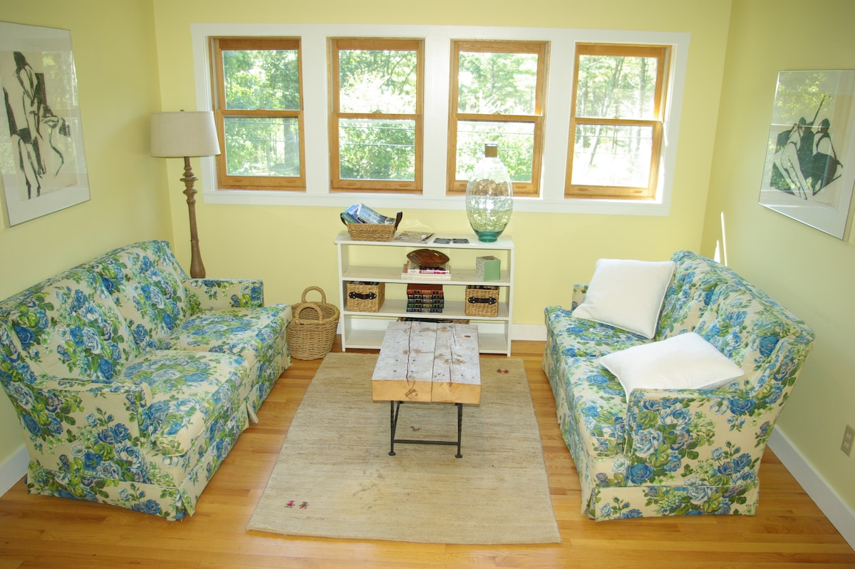 Sunny riverside carriage house
