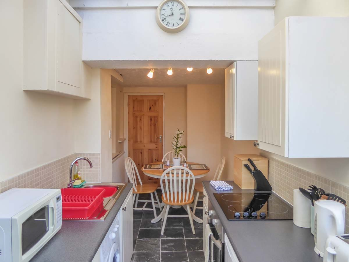 Fully Equipped Kitchen with Modern Appliances, Four Seater Dining Table