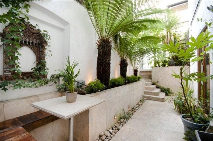 Tropical & travertine designer garden with eating area