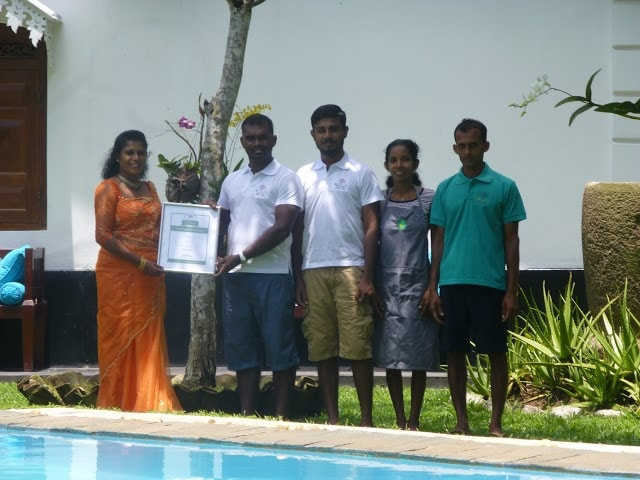 Villa team receiving certificate of excellence for 2014