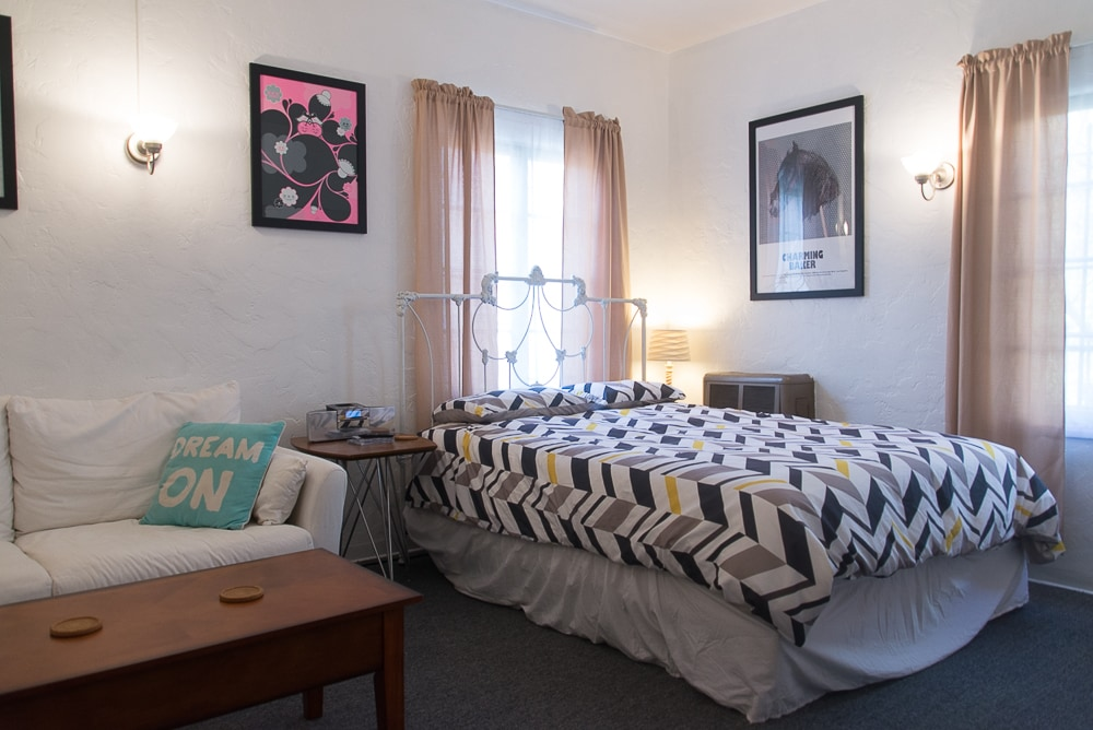 The comfortable studio room. With Cozy Queen bed, comfy sofa, TV, coffee table, work desk & separate kitchen area with dining nook