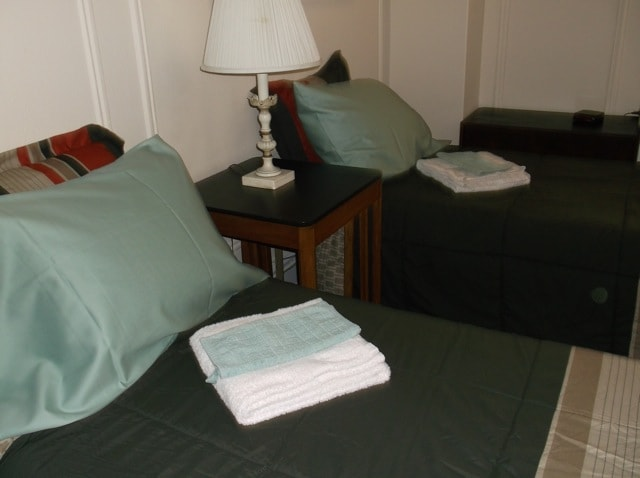 SW corner of guest room with 2 single beds.