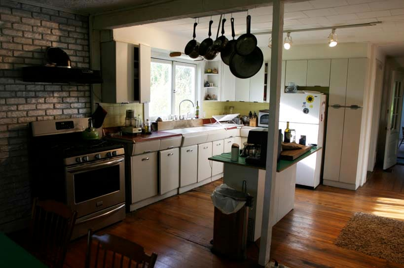 Fully equipped kitchen has a new stove, original metal cabinets, coffee/cappuccino maker.