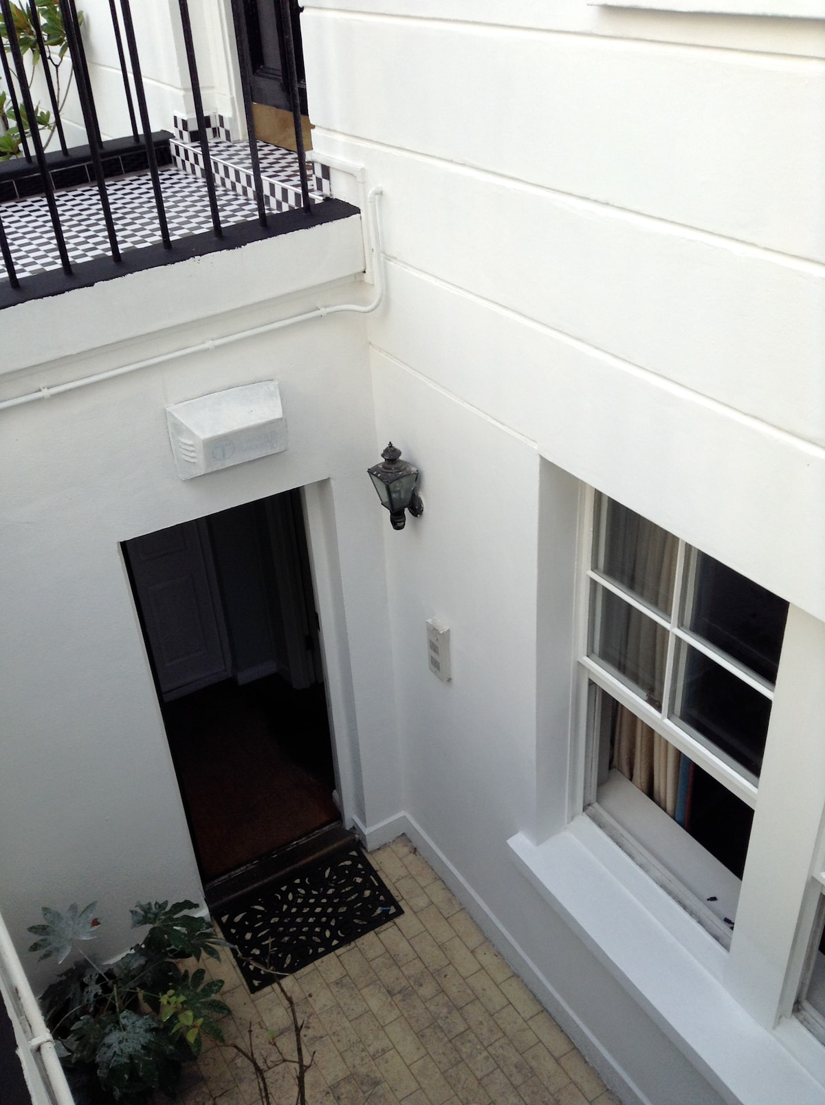 front door, two large window look over the front area