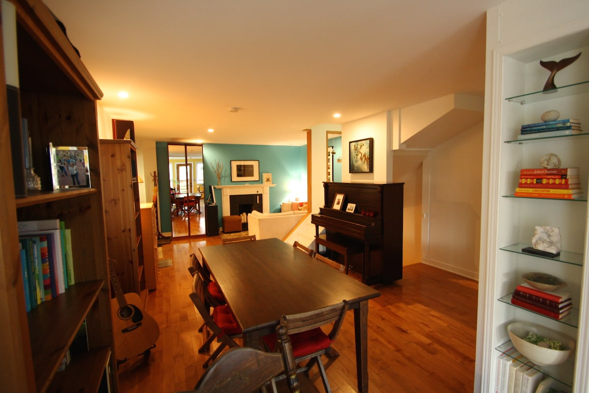 Dining room: our floor plan is open, and the piano loves to be played!