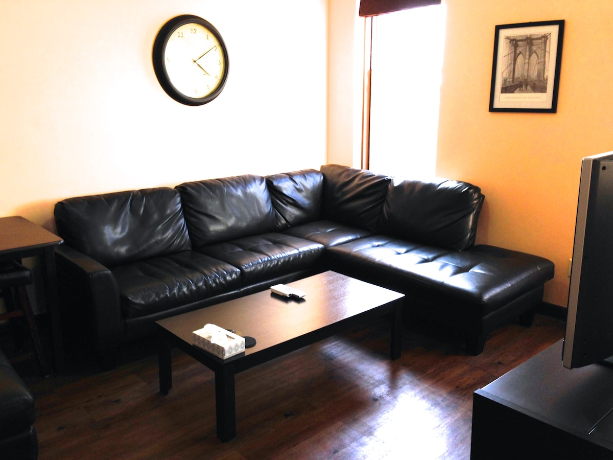 Living room. Sofa, coffee table, TV. The sofa is not a sofa bed.