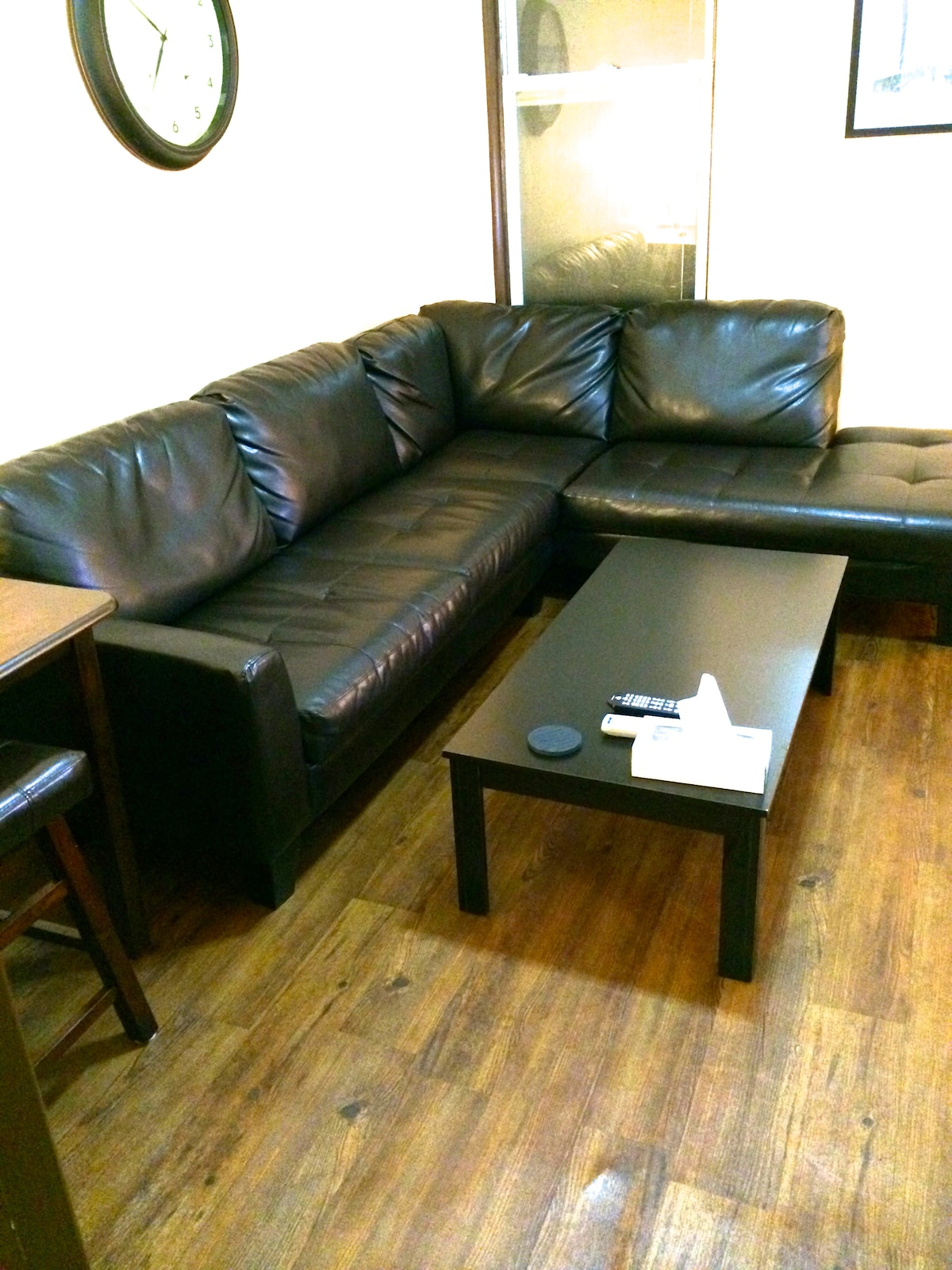 Living room, sectional sofa, not a sofa bed.