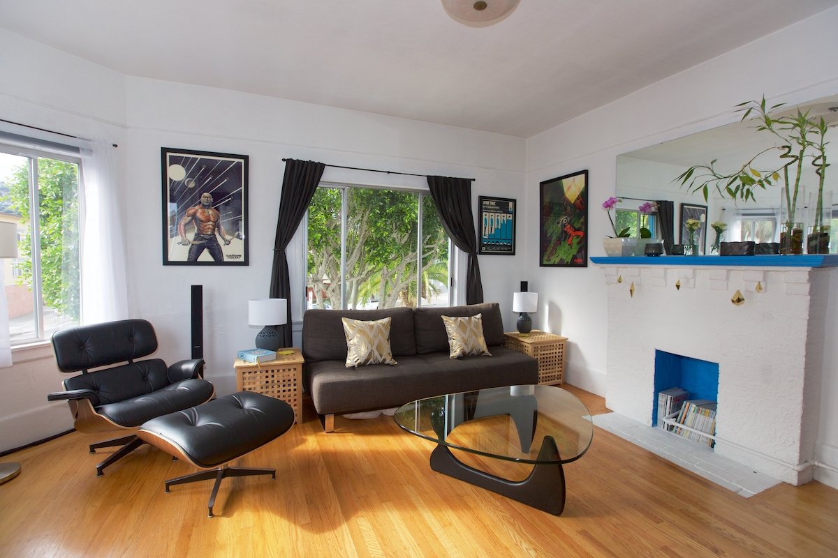 Great light makes for a comfy place to sit and read. Or tilt the TV and watch from the Eames lounge chair.