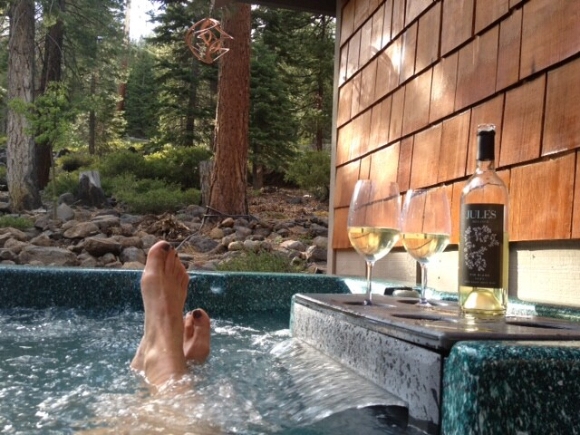 Relaxing in the spa on the back deck overlooking the forest (Nov-May).