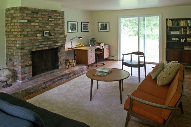 Main living room, fireplace, flat screen TV for films, desk for writing that novel, sleeper sofa, books and board games, sliding doors out to field and birch woods, small deck with seating.