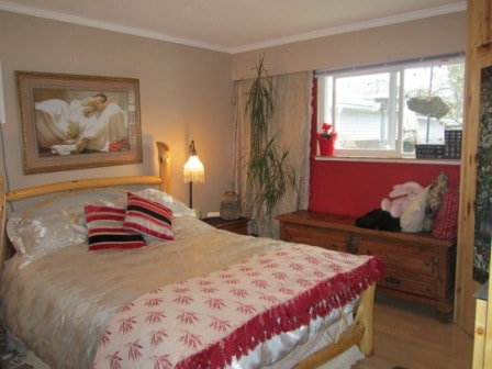 Master Bedroom with feather bed, heated mattress, air conditioning, electric fireplace and brand new mattresss