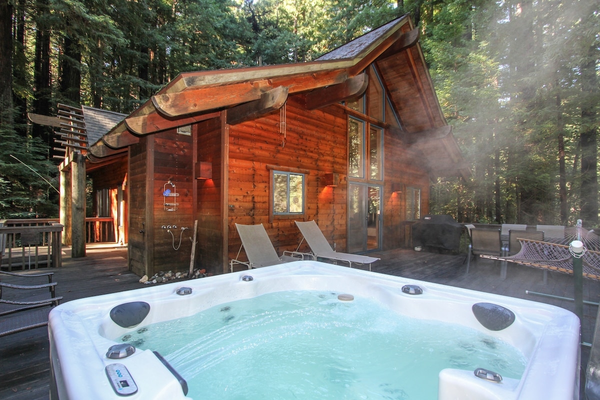Let the world slip away as you relax under the redwoods in the hot tub!