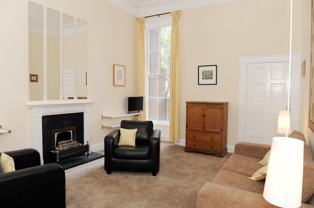 aliving room with double sofabed tonthe right, fireplace and cable tv