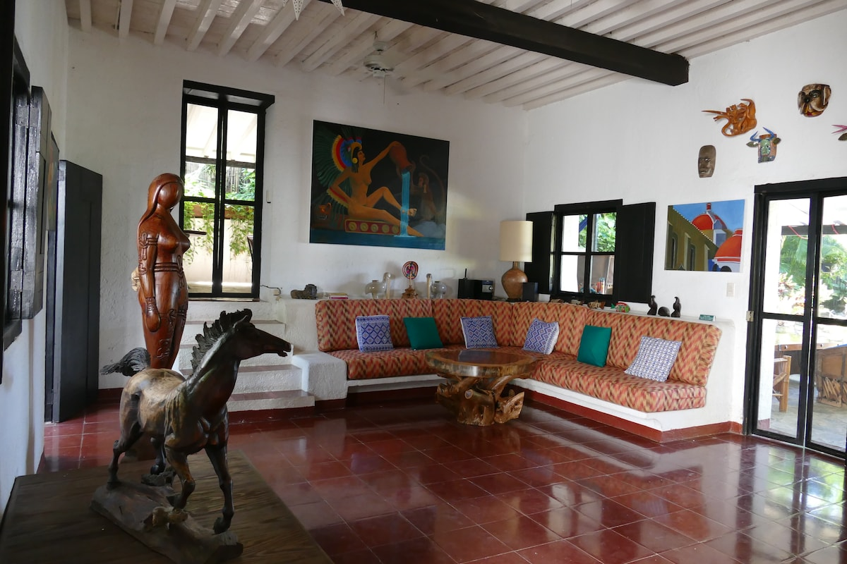 Lower House Living area - decorated with original oils, custom carvings, and a cool mask collection from Tocuaro