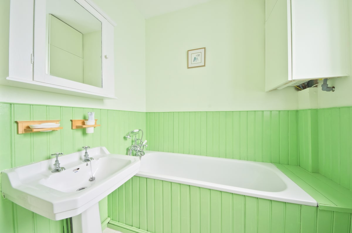 There is a large bath (perfect for a long, relaxing soak)  and a hand-held shower.