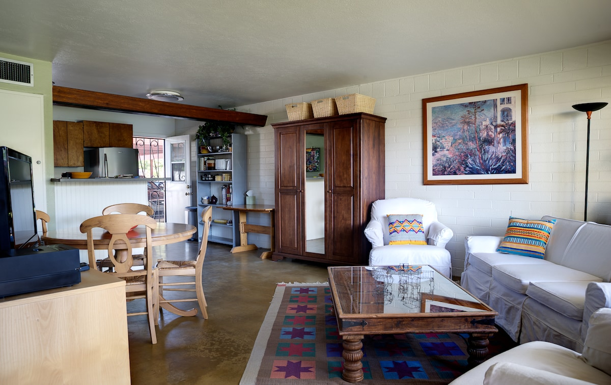 Living and Dining Areas.  Kitchen in the background