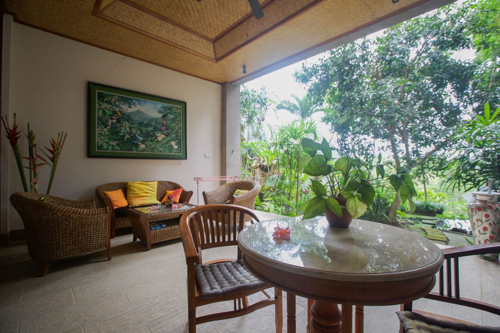 Outdoor living on your verandah overlooking lush tropical gardens..