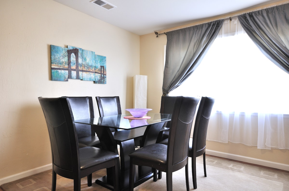 Up to six of your family and friends can indulge in a home-cooked meal in this dining room with ample natural light!