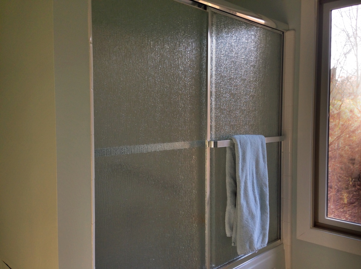 Tub and shower with glass enclosure