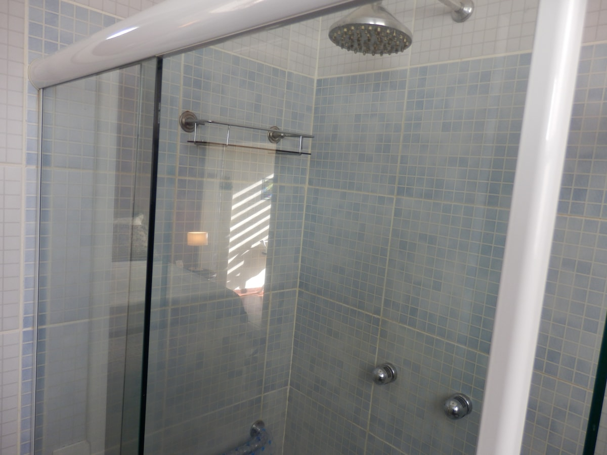 Your spacious shower with rainfall shower head