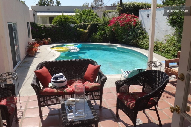 This is your pool and your private separate Your Guest House is on the left of the swimming pool This is not the patio you will be using.  You will be using the patio adjacent to the barbecue and of course you can use the patio surrounding the entire pool