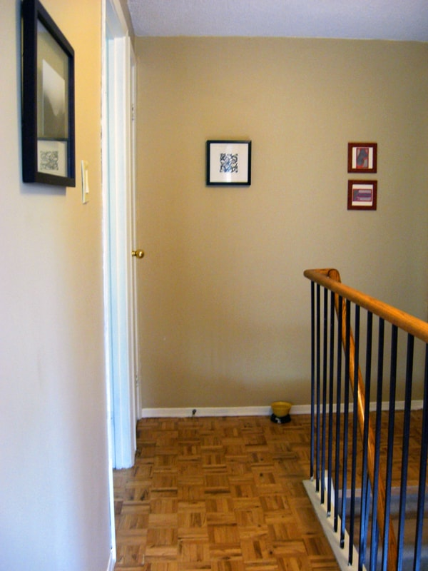 View from the room into the hallway. All original art on the walls.