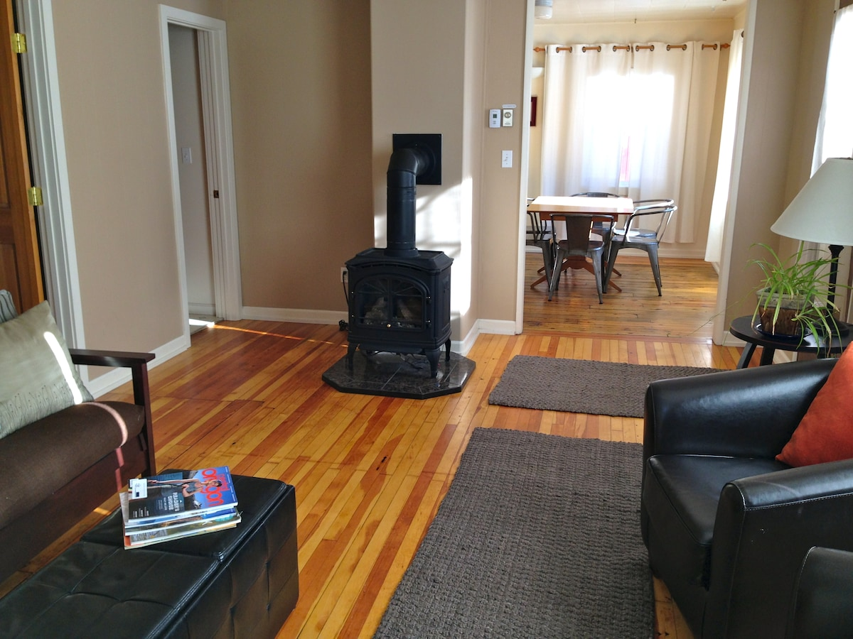 Our living room with finished wood floors from the original 1920's construction...beautiful and warm-toned!