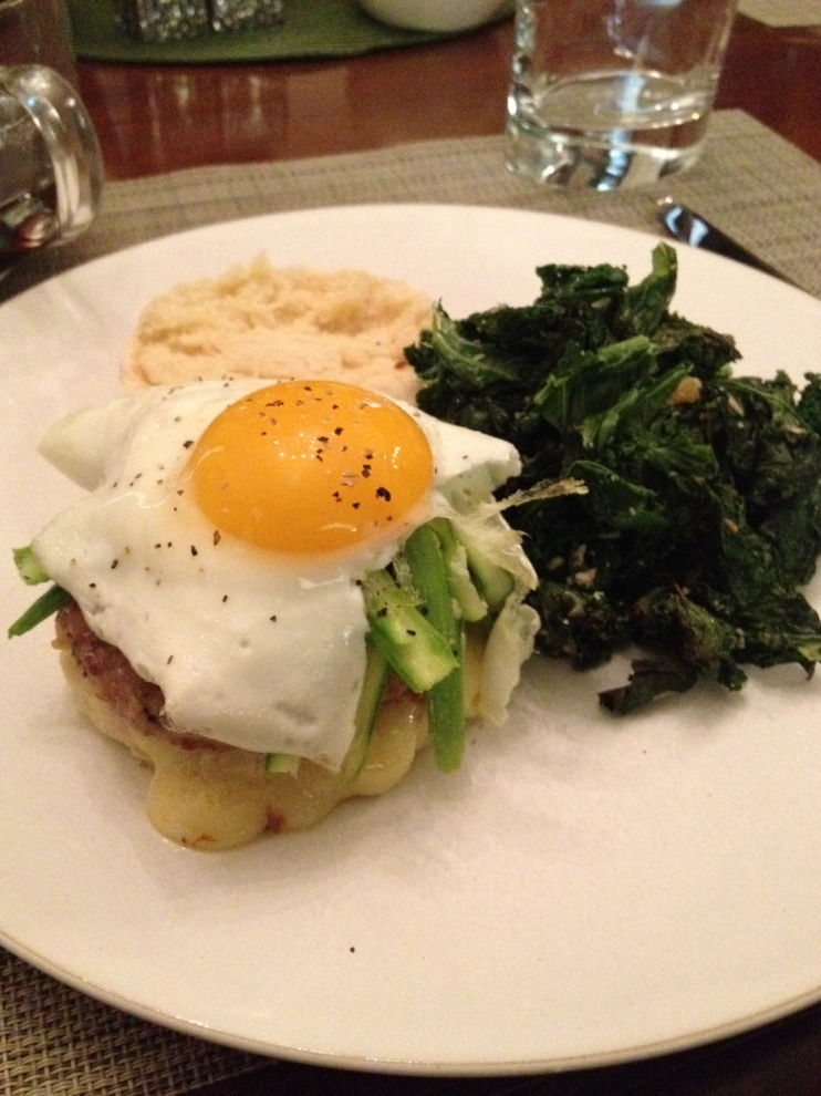 Sunnyside up egg on a biscuit with house made sausage, Grafton cheddar and shaved spring asparagus