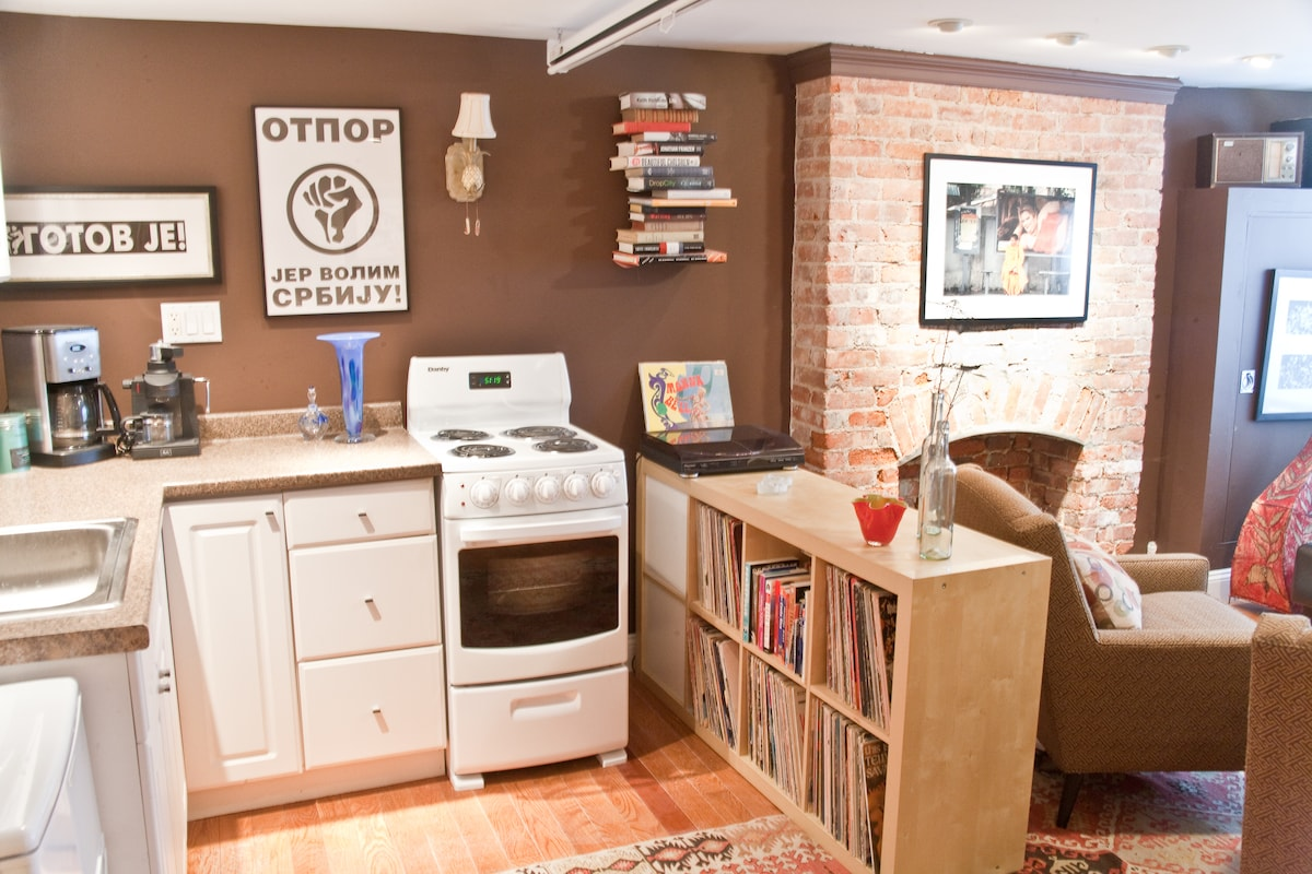 Apartment includes full kitchen with refrigerator, stove/oven, and cooking supplies