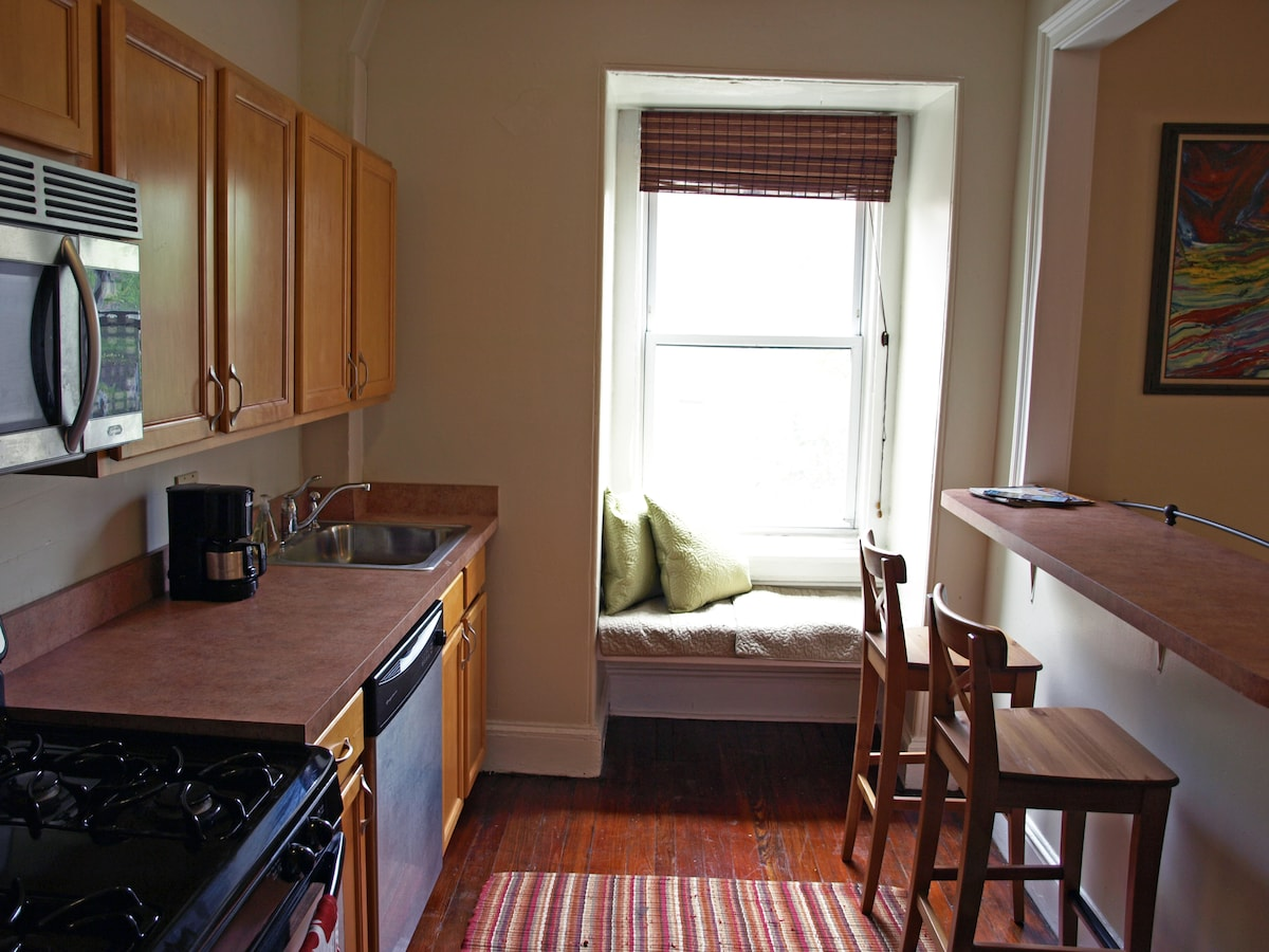 renovated kitchen with stainless steel appliances and coffee maker