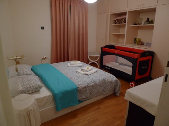 This is the master bedroom with 1 double bed. Baby-cot and baby chair are also provided
