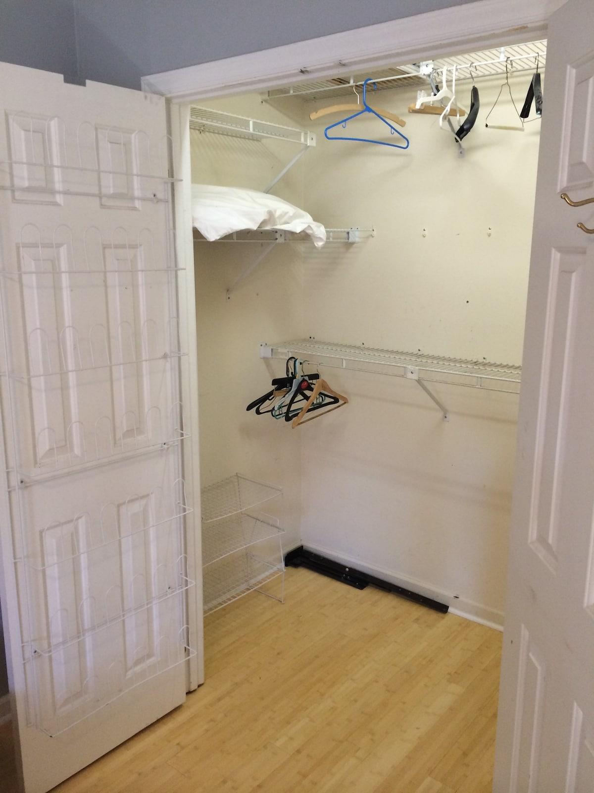 Walk in closet in master bedroom.