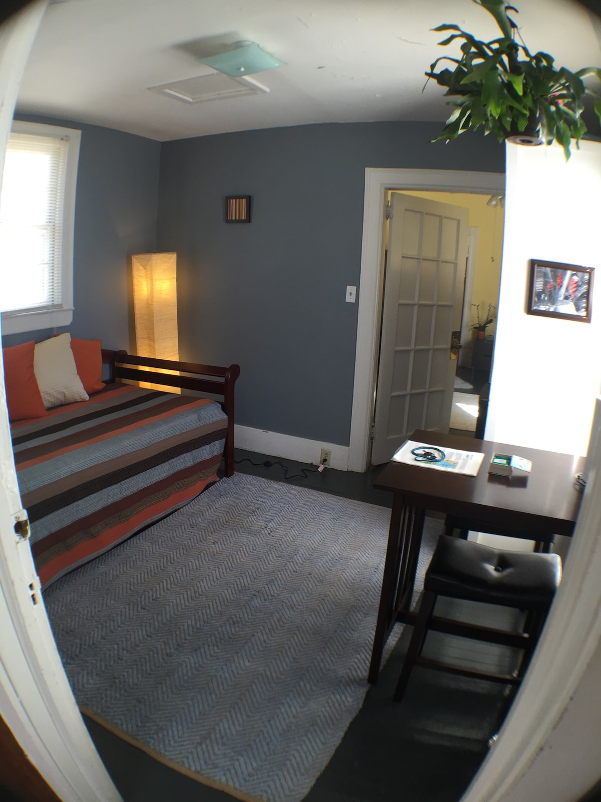 Second (smaller room) with view of daybed and breakfast table.