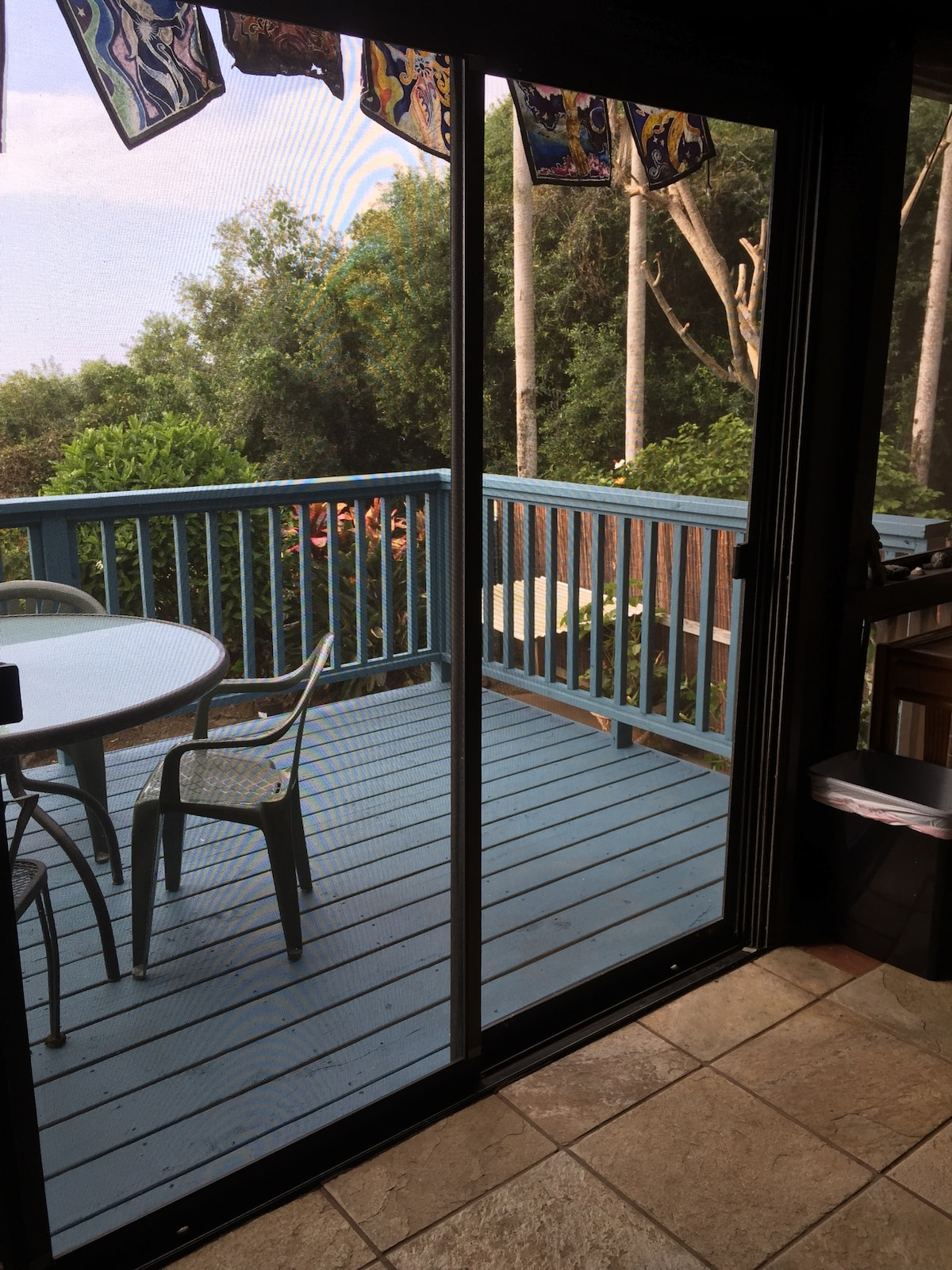 Step out to the outdoor lanai. Great place for enjoying a meal or morning yoga.