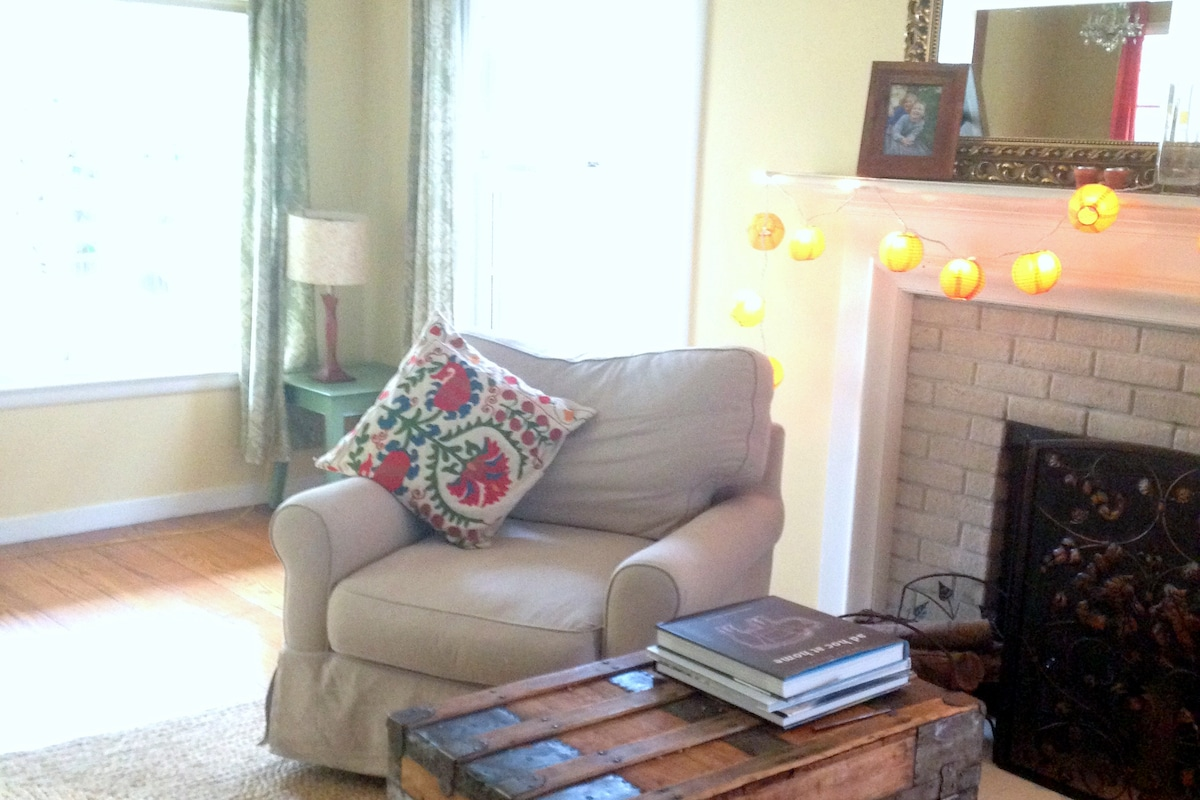 Large, cheerful living room with plenty of space to relax.