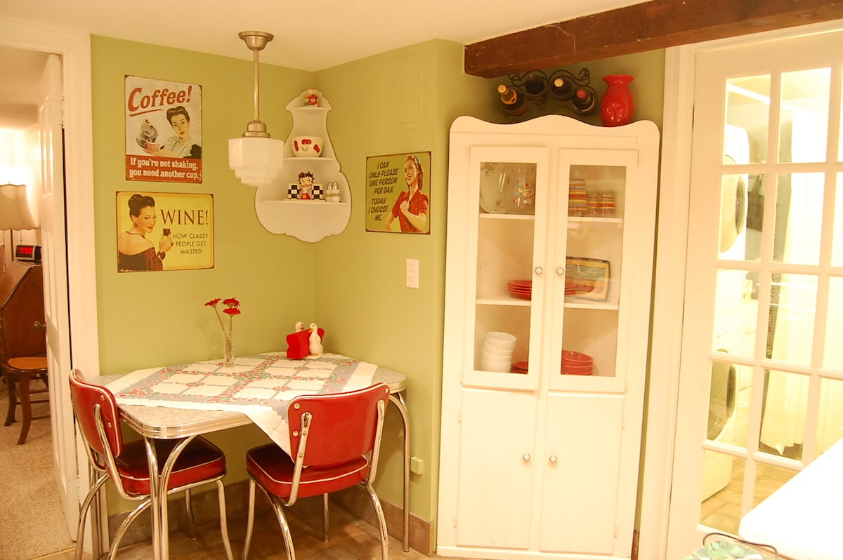 Vintage eating area and corner cupboard with Fiesta Ware dishes.