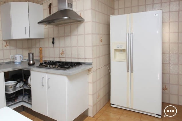 kitchen and fridge with cool water and ice dispenser.