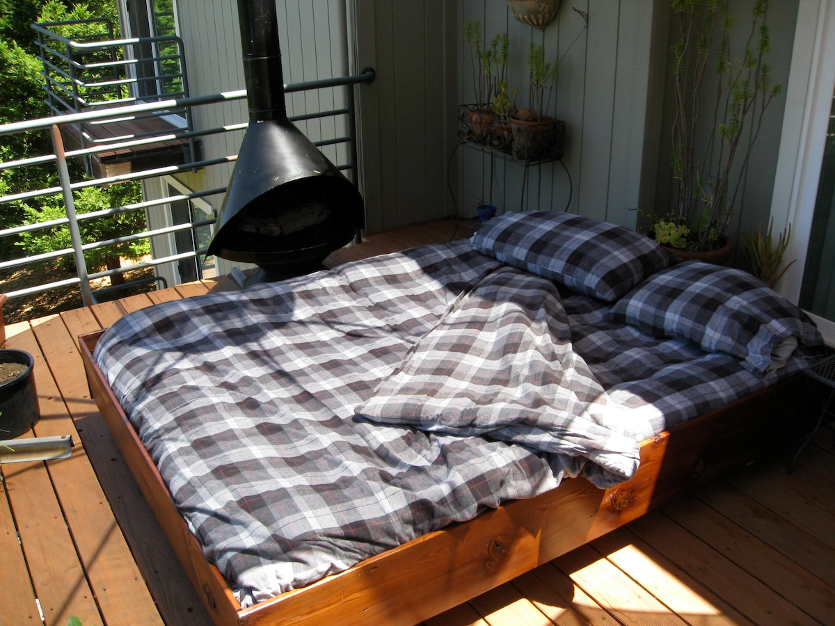"Outdoor ""bedroom"" features a queen sized air bed w/ down comforter, fireplace & amazing views of the night sky."
