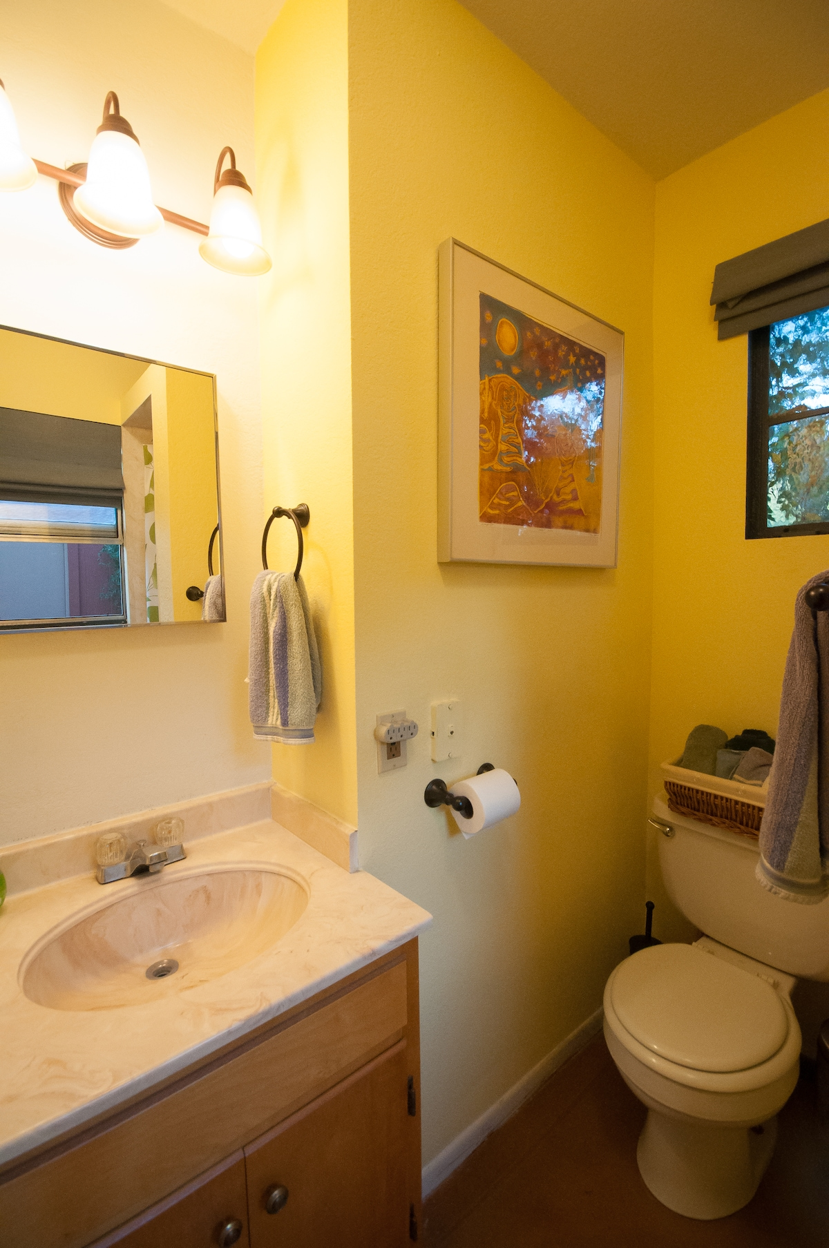 Private bathroom with vanity sink and shower.