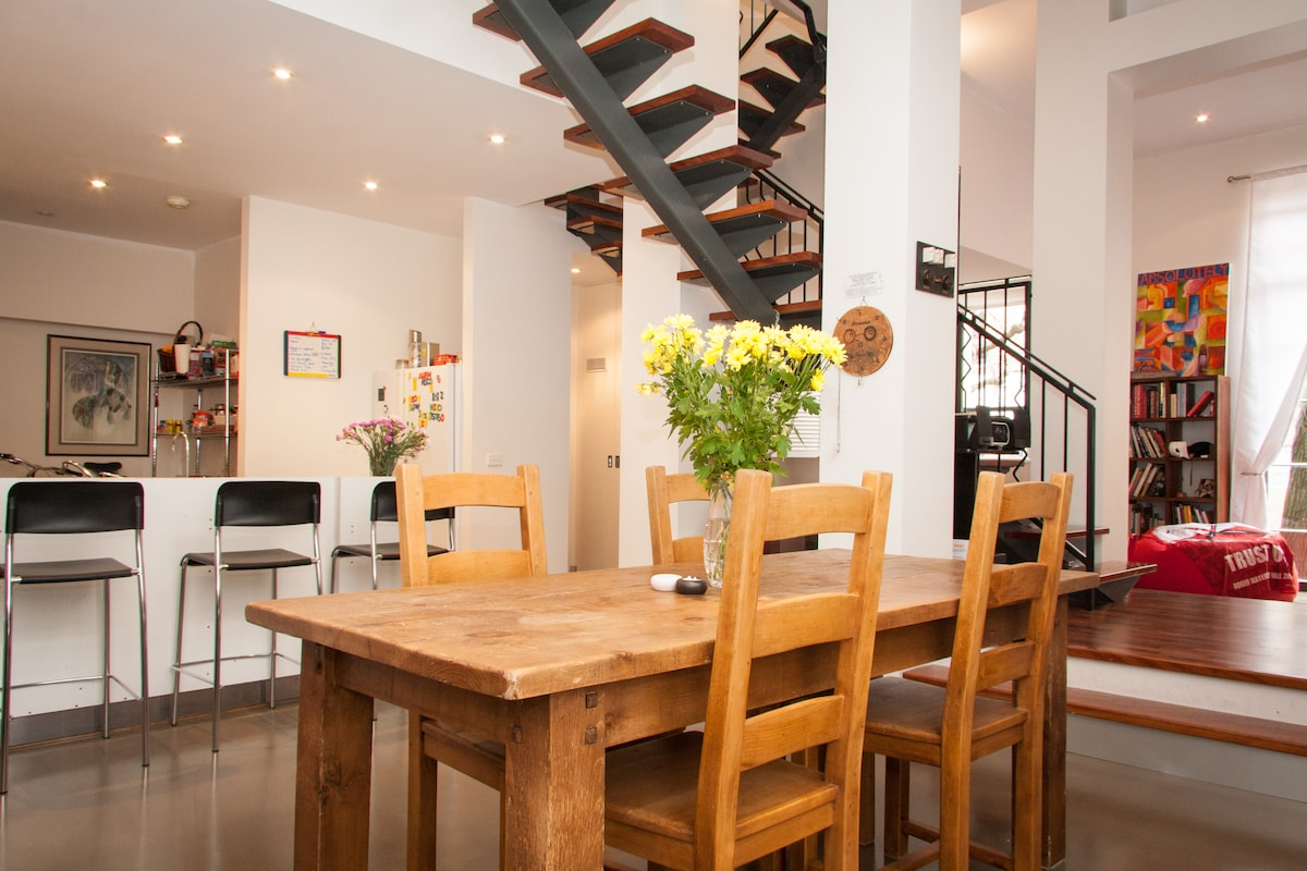 An overall view of the dining areas, living room and kitchen