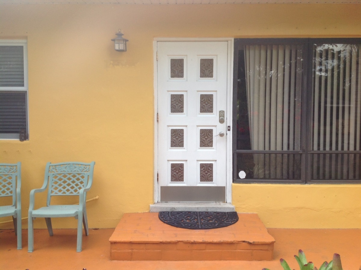 Front door with the new color of the house.